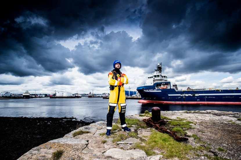 Survivex shoot, posed in front of boat in Aberdeen Harbour