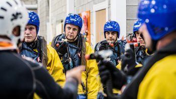 Trainer talks during a class for offshore survivals in Aberdeen.