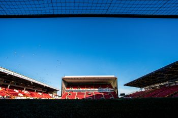 A photo of Pittodrie Stadium from within the goal mouth looking onto the beach end.