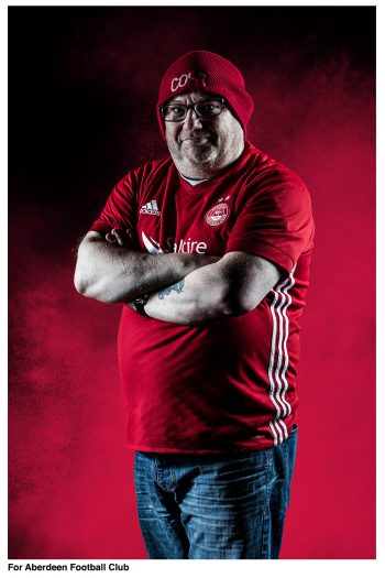 Commercial photography of Aberdeen FC fan posing by scott cameron baxter photography