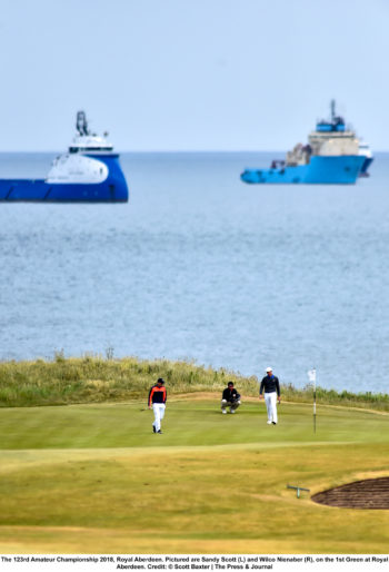 Golfers Sandy Scott (L) and Wilco Nienaber (R), on the 1st Green at Royal Aberdeen. Taken by Scott Baxter