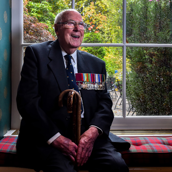 Image of a WW2 veteran, links through to the Editorial portfolio