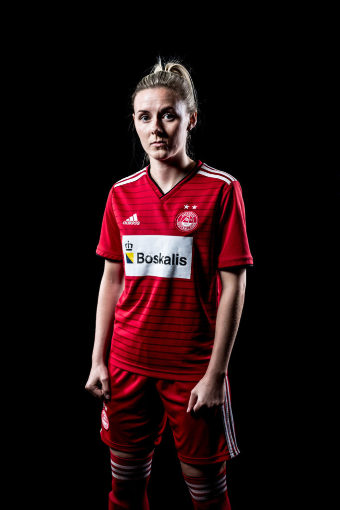Aberdeen FC women player poses for a studio photograph for an advertising feature for the Aberdeen FC women player of the year awards poster.