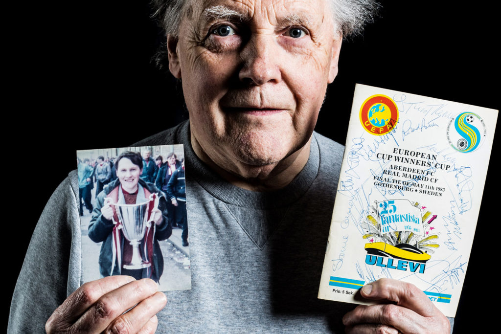 A man today holds a picture of himself as a boy back in 1983 holding the European Cup Winners Cup.