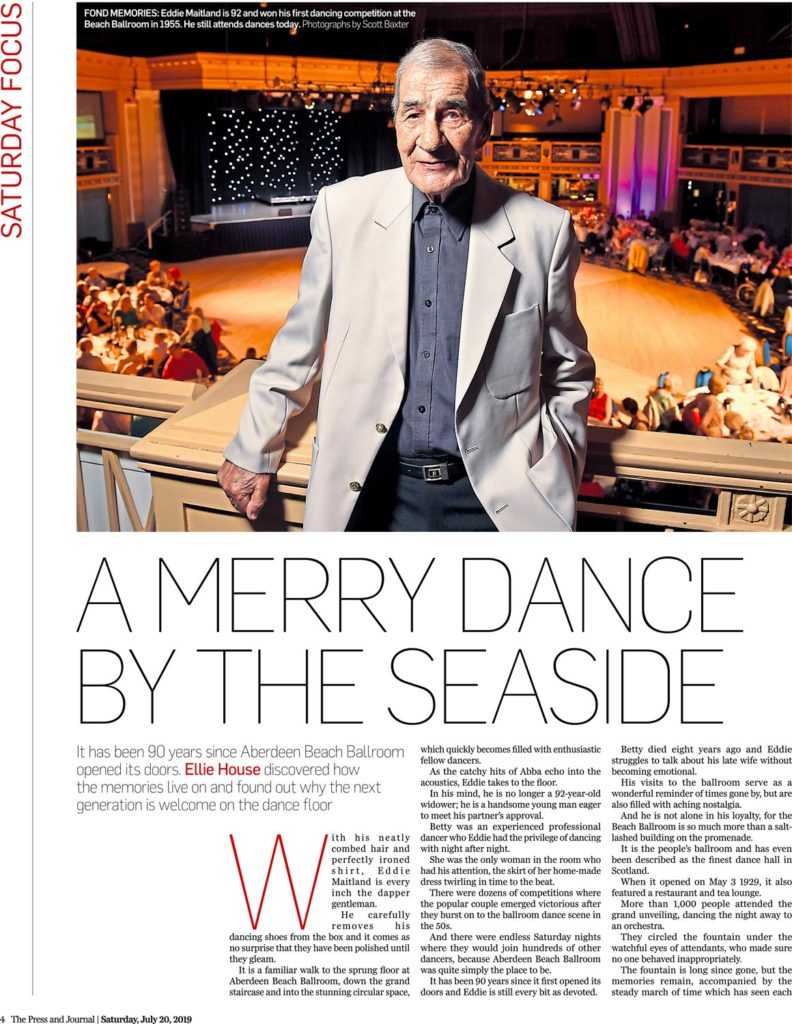 A ballroom dancer who is 92 years old poses at the Aberdeen beach ballroom balcony