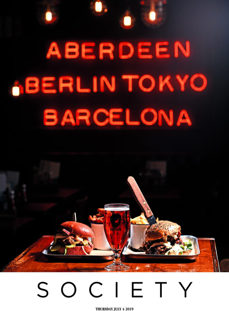 PR Photography: Front cover of the magazine Society,, featuring BrewDog Bar in Aberdeen show food and drinks with signage in the background