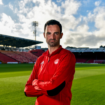 Joe Lewis posing at Pittodrie Stadium, links to the Sports portfolio