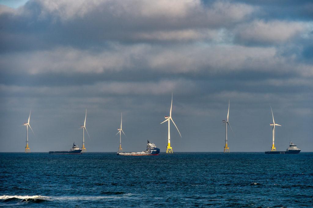 Windfarm off the coast of Aberdeen, Scotland, with support vessels.
