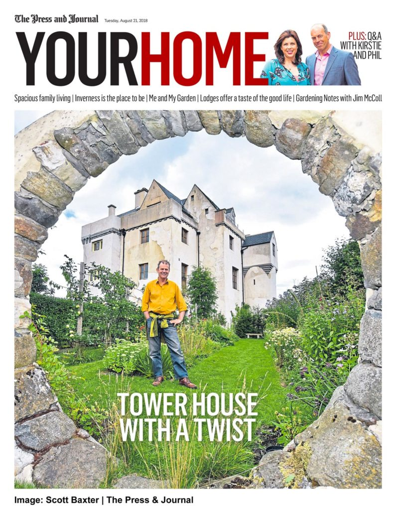 Front Cover of YOUR HOME shows a man with a castle he built through a moon gate.