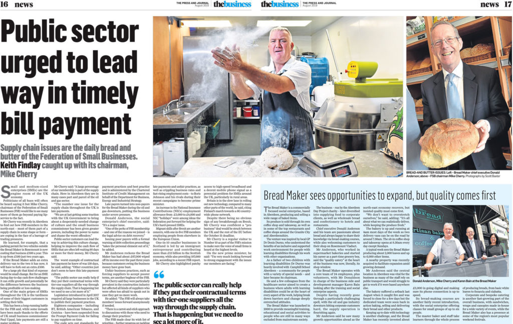 Editorial Photography Aberdeen - A business feature of The Breadmaker Aberdeen, a man claps his hands covered in flour making a cloud of flour in a bakery.