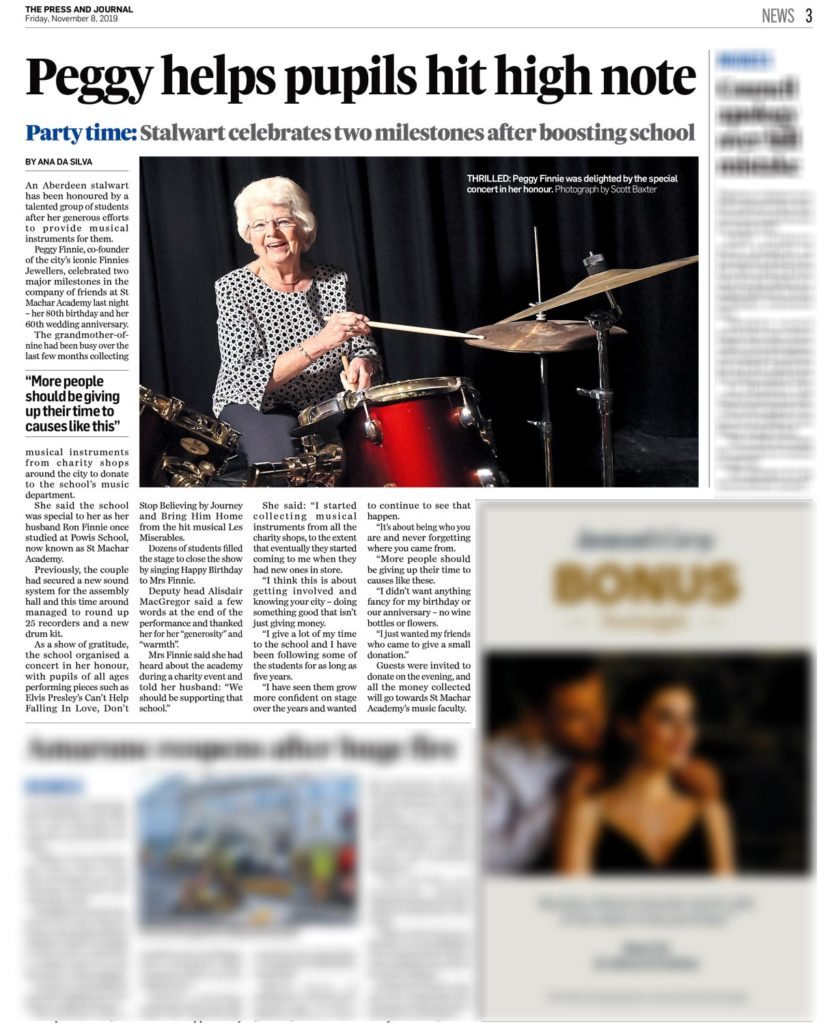 Editorial photo by Scott Cameron Baxter. Picture shows Peggy Finnie playing drums after she donated them to a school for music classes. black background and red drum kit. she has drum sticks in hand.