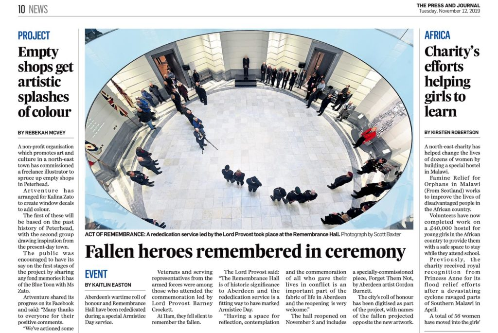 A picture from the top of the circular glass rooftop of the remembrance hall at Aberdeen Art gallery. Picture shows people observing a ceremony for remembrance day from a top down view. Editorial photo by Scott Cameron Baxter.