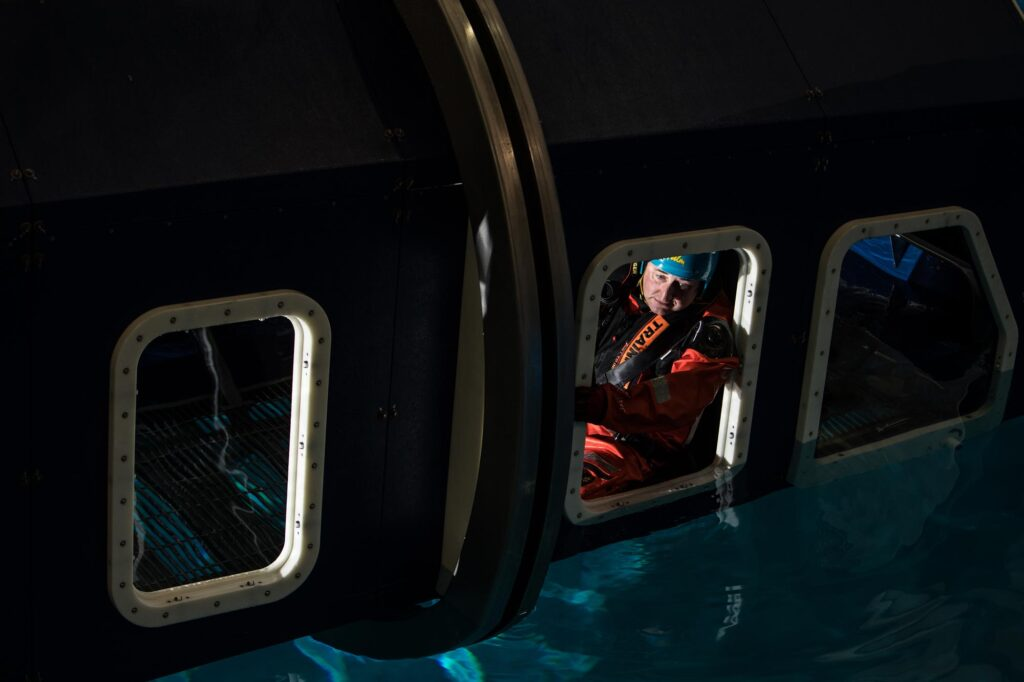 Commercial Photographer Aberdeen - Scott Cameron Baxter. Image shows a man in a HUET during a offshore survival training helicopter ditch.